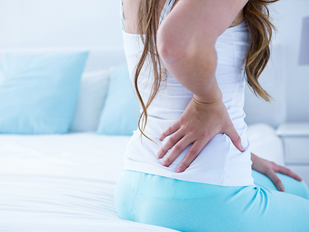 chronic-pain-woman-back-pain-450x338