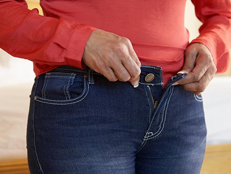 creatine-woman-buttoning-pants-450x340