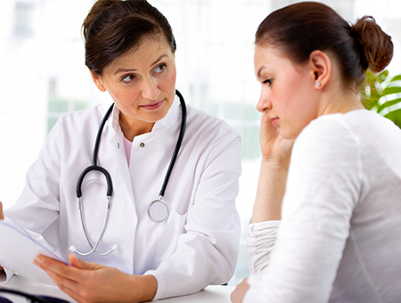 doctor-and-patient-looking-at-report-450x340