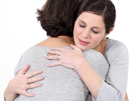 domesticabuse-intimatepartnerviolence-friendshug-450x338