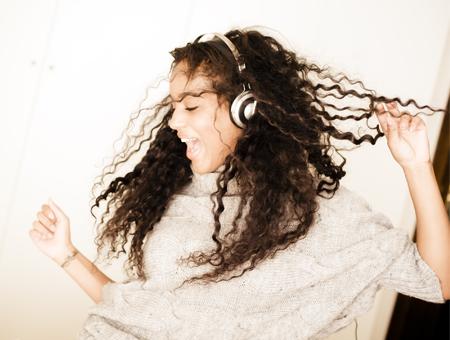 hierarchy-woman-dancing-headphones-450x340