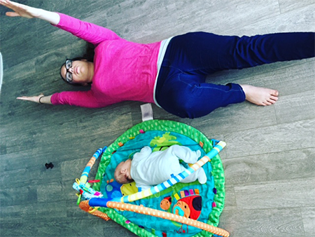 jessie-working-out-on-floor-with-baby-450x338