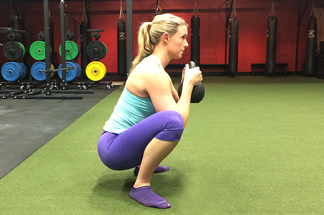 Molly Galbraith demonstrates a goblet squat.