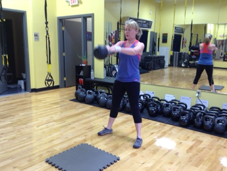 older-women-training-kettlebell-swings-450x338