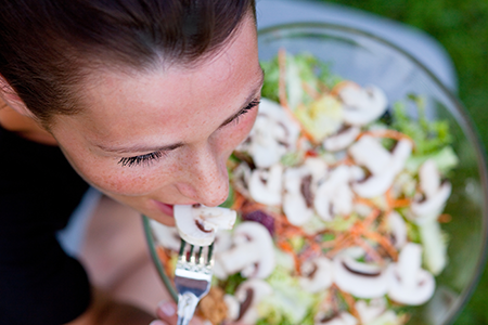 recovery-woman-eating-BAS-Salad-450x300