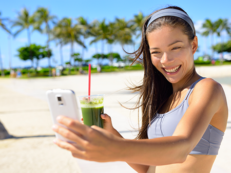 social-media-taking-selfie-with-smoothie-450x338