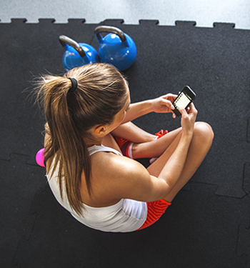 social-media-woman-on-phone-at-gym-350x375