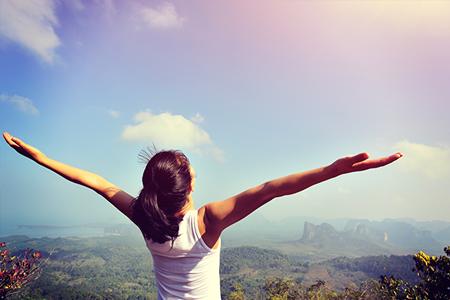 woman-celebrating-feeling-good-hiking-450x300