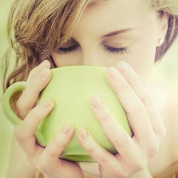 woman-drinking-tea-green-cup-350x351