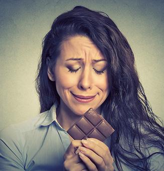 women-and-stress-woman-chocolate-327x341