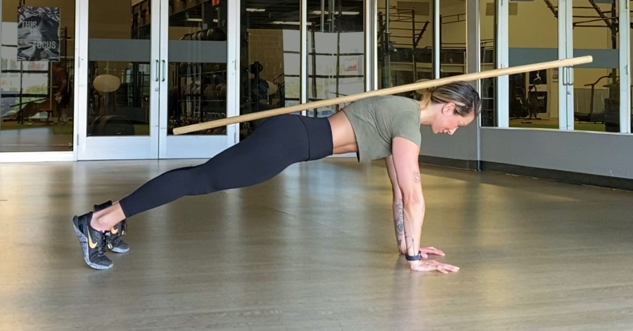 Jen Comas demonstrates proper alignment in the starting position of a push-up